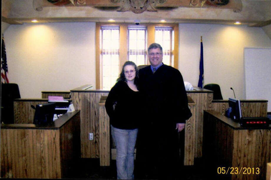 Melissa LeMieux-Burns with Midland County Circuit Court Judge Michael Beale after a graduation ceremony at the Midland County Courthouse.