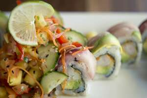 BRITTNEY LOHMILLER | blohmiller@mdn.net The mahalo roll, made of tempura shrimp, avocado, spicy mayo, topped with yellowtail and served with a pineapple salad, is one of the signature rolls offered at Maru Sushi and Grill.