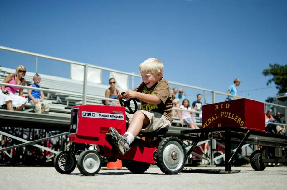 Jack Ivan, 5, competes in the children's Pedal Pull Tuesday at the Midland County Fair. Ivan won first place in his age division. Photo: NICK KING | Nking@mdn.net
