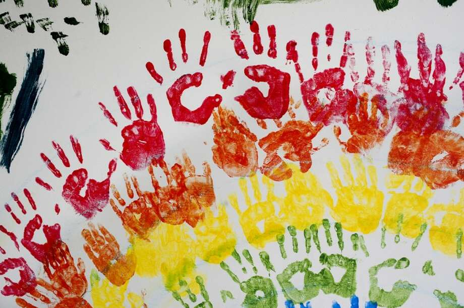 "NEIL BLAKE | nblake@mdn.net Handprints form a rainbow on the ""Peace Mural"" at the Midland Church of the Brethren. The mural is a collaborative art project to go along with the church's Vacation Bible School program which is entitled ""Kids as Peacemakers."" Each night the children work on art pieces that will be added to the mural which will be displayed on Friday at the church. Photo: Neil Blake"
