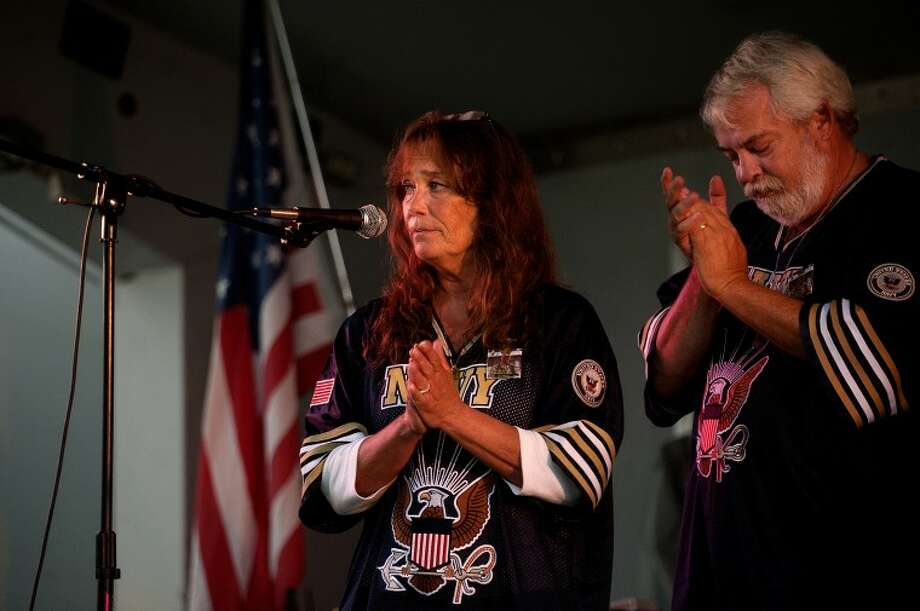 NICK KING | nking@mdn.net Debi Bartley-Ullom, left, and her husband Kevin Ullom address the crowd Tuesday during a benefit for their son Aaron Ullom, the 20-year-old U.S. Navy hospital corpsman who was killed in Afghanistan, Tuesday at The Creek Bar and Grill. A portion of the proceeds from the event will go toward a bench at Aaron's grave and a plaque commemorating his life. Photo: NICK KING | Nking@mdn.net