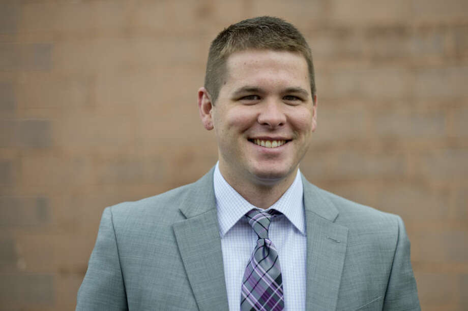 NICK KING | nking@mdn.netScott Holzinger is working as a detective for the Midland County Sheriff's Office. Photo: Nick King/Midland  Daily News