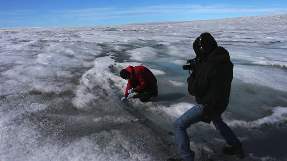 Midland native Peter Sinclair trains a camera on Dr. Marek Stibal, of the Danish Geologic Survey. Stibal was taking samples of the ice sheet to determine the effects of man-made pollution on the rapid melt of arctic ice.