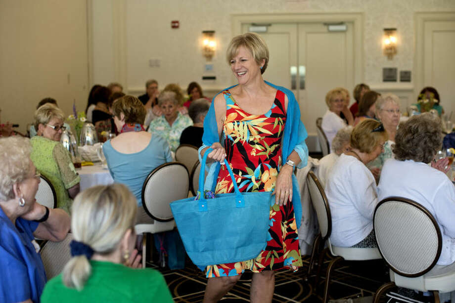 NICK KING | nking@mdn.netBarbara Hagler walks through the crowd while modeling an outfit during a MidMichigan Medical Center-Midland Gift Shop fashion show as part of a Midland Women's Connection 'Stepping Out' luncheon at the Midland County Club. Photo: Nick King/Midland  Daily News