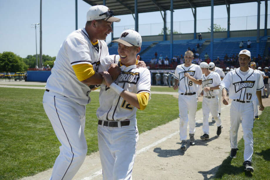 NEIL BLAKE | nblake@mdn.netBay City Western's Brendan Harrison, left, celebrates with Brendan Taberski after their 2-1 state semifinal win over Sterling Hts. Stevenson at C.O. Brown Stadium at Bailey Park in Battle Creek on Friday.