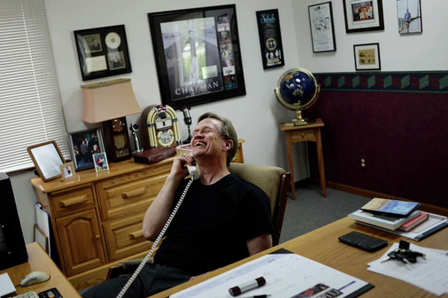 """Peter Brooks, of Midland, laughs while talking to Ann Diehl, the administrative assistant at Family Life Radio in Midland, while doing office work on Wednesday afternoon. Brooks has been the general manager and morning show co-host at WUGN Family Life Radio in Midland for 25 years — his first job at an AM radio station in West Branch when he was 16. """"I've always enjoyed people, and I've always enjoyed entertaining,"""" Brooks said. """"I can do what I think I have the ability to do and share my faith. That's what I'm passionate about."""" Photo: Sean Proctor/Midland  Daily News / Midland Daily News"""