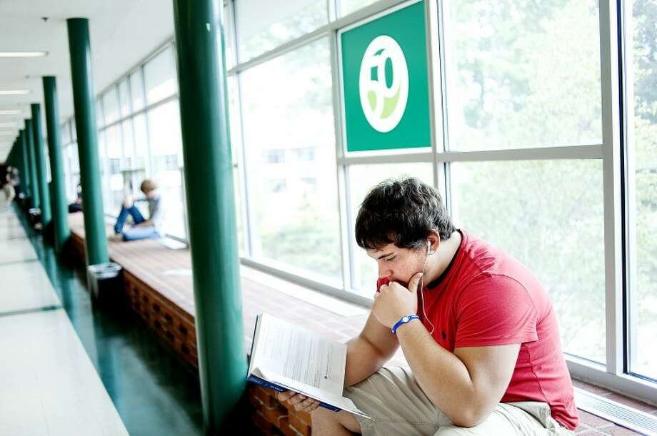 Sophomore Joe Konsdorf, of Freeland, reads up on chemistry in the hall way Monday on the Delta College campus. Delta College marks the 50th fall semester of classes with the majority of students starting the week of Aug. 29. Photo: Nick King