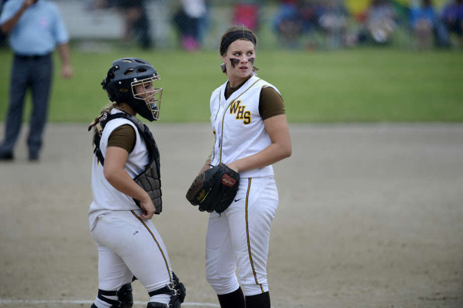 NEIL BLAKE | nblake@mdn.netBay City Western's Haley Bickham, left, and Hannah Leppek confer during the division 1 state championship game against Mattawan at Bailey Park in Battle Creek on Saturday.