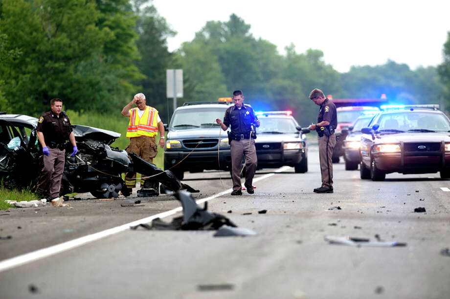 THOMAS SIMONETTI | tsimonetti@mdn.netMidland County Sheriff's deputies and emergency responders work the scene of a Tuesday afternoon accident on M-20 in Midland County. Photo: Thomas Simonetti\u002fMidland  Daily  / Midland Daily News