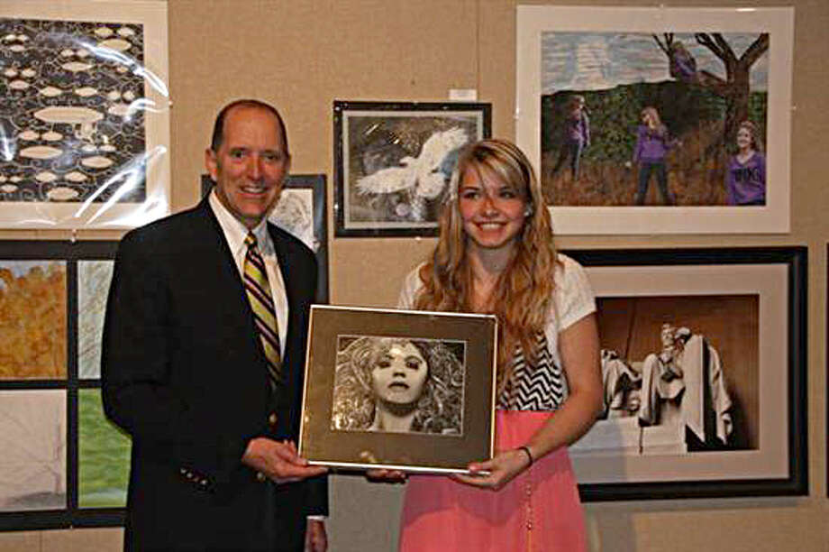 Congressman Dave Camp, R-Midland, is shown with Brooke Horton of Lake City High School.