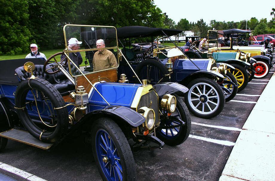 STUART FROHM for the Daily NewsFrom left, a 1910 Oakland, 1911 Hudson 33, 1912 Oakland and 1931 Ford are among cars parked at Independence Village of Midland, 2325 Rockwell Drive, for an antique car show during a recent three-day tour of the Horseless Carriage Club of America.