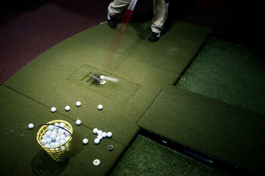 THOMAS SIMONETTI | tsimonetti@mdn.netGolf balls are hit into a screen on the indoor golf simulator at Big Al's Golf in Midland. After each shot, a readout gives golfers an idea how well the ball was hit. Photo: Thomas Simonetti