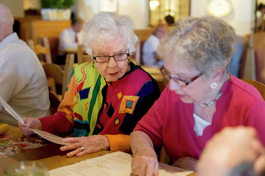 NEIL BLAKE | nblake@mdn.netEleanor Kramer, left, and Barbara Stoughton look over the menu at the Olive Garden in Midland. The women are part the Out to Lunch Bunch and meet up at a local restaurant each month. All the club members live at Riverside Place.