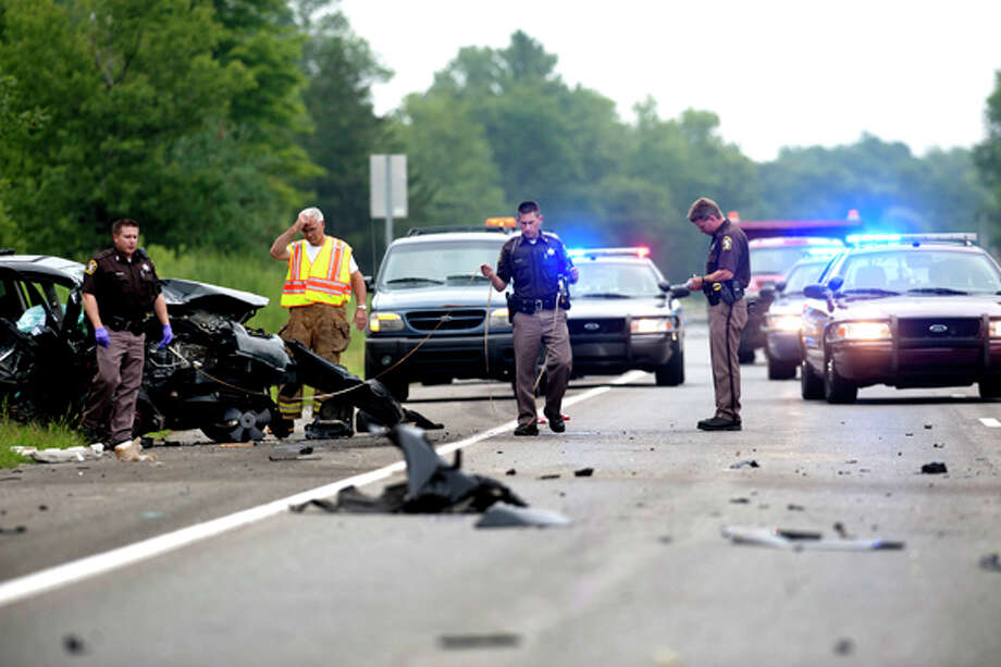 Midland County Sheriff's deputies and emergency responders work the scene of a Tuesday afternoon accident on M-20 in Midland County. Photo: THOMAS SIMONETTI | Tsimonetti@mdn.net  / Midland Daily News
