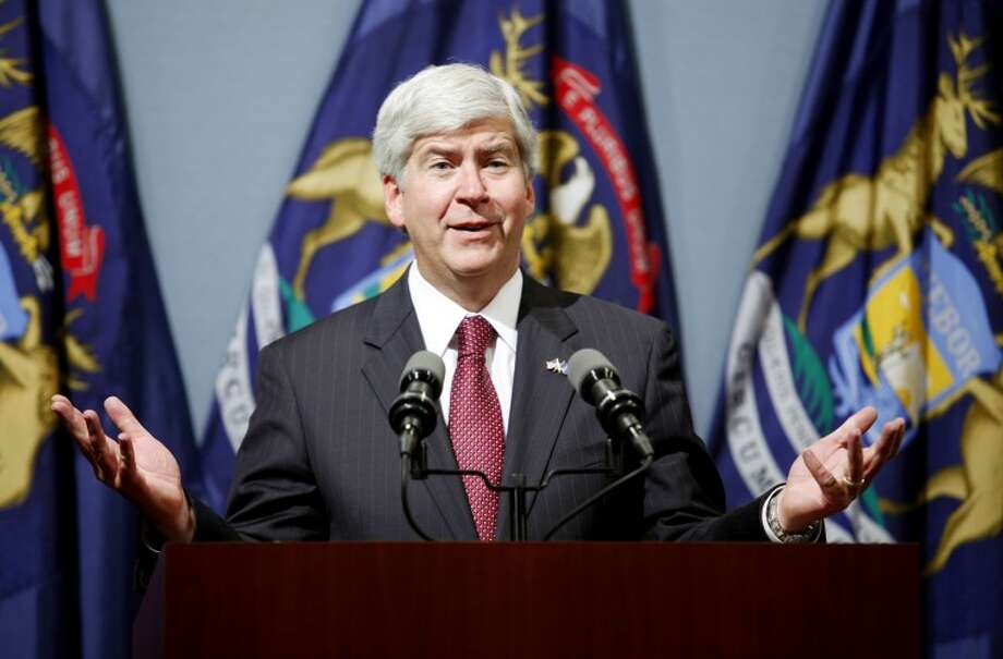 Michigan Gov. Rick Snyder talks about his budget proposal during a news conference, Thursday in Lansing. (AP Photo/Al Goldis) Photo: Al Goldis