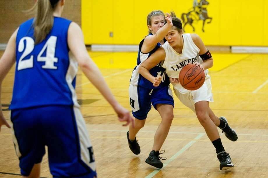 THOMAS SIMONETTI | tsimonetti@mdn.netBullock Creek's Kendra Shankel, right, tries to dribble around Hemlock's Kendal Ward on Tuesday at Bullock Creek. Photo: Thomas Simonetti