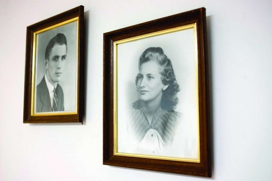 THOMAS SIMONETTI | tsimonetti@mdn.netHigh school graduation photographs of Bud Keilitz and Marie Ducham hang in their Midland home. The pair, celebrating their 70th wedding anniversary today, met in typing class at Midland High. Photo: Thomas Simonetti/Midland  Daily