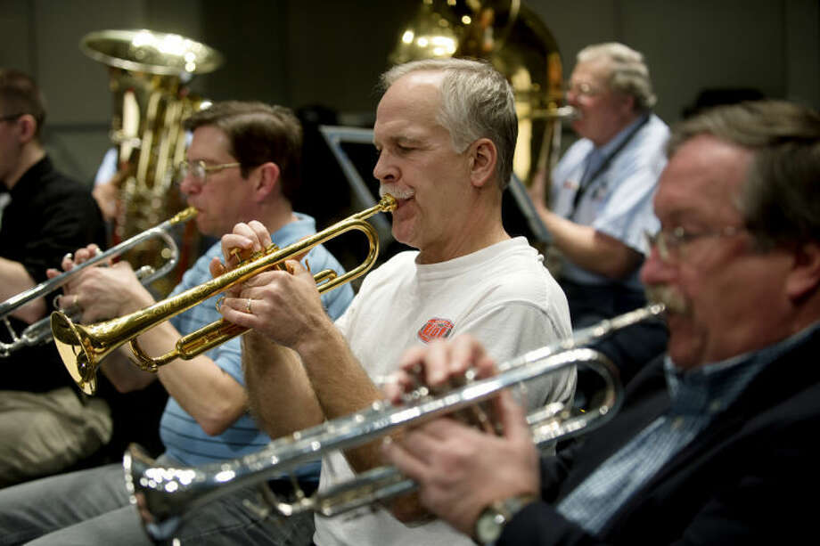"NEIL BLAKE | nblake@mdn.net Midland Concert Band member Rick Enszer, center, plays trumpet between Dave Selley, left, and Mark Brissette during rehearsal on Thursday. They will perform their winter concert ""Fond Memories, Beautiful Places"" on Sunday at 3 p.m. Photo: Neil Blake/Midland  Daily News"
