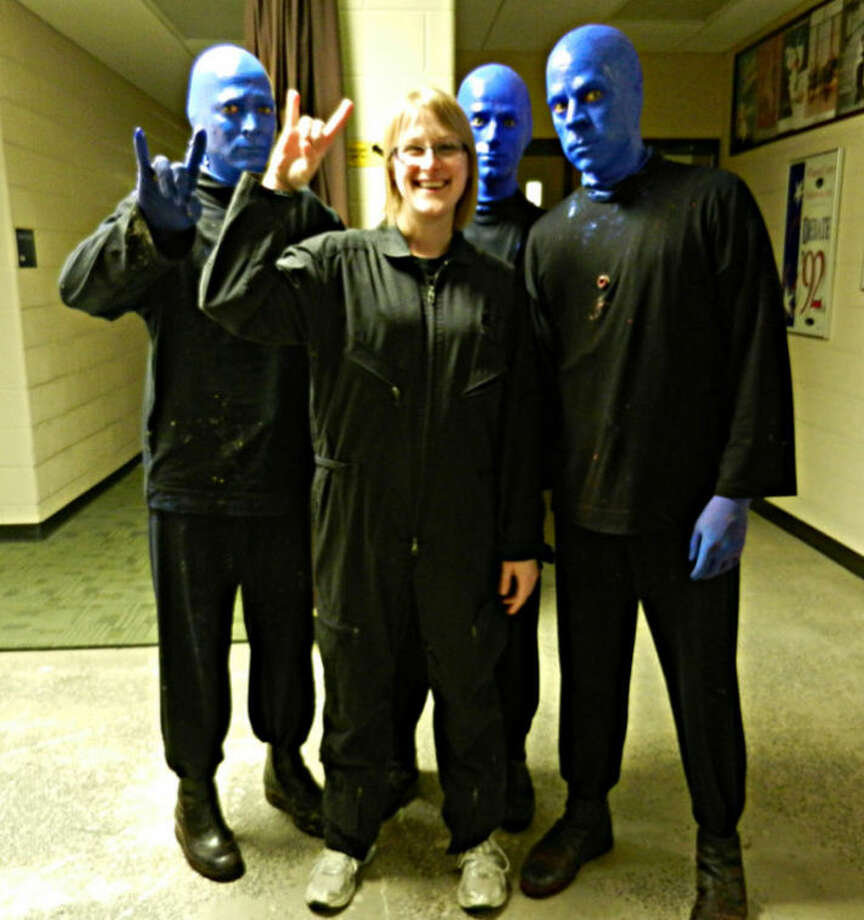 Photo providedElizabeth Gisse, 21, is shown with members of the Blue Man Group at their performance in East Lansing.