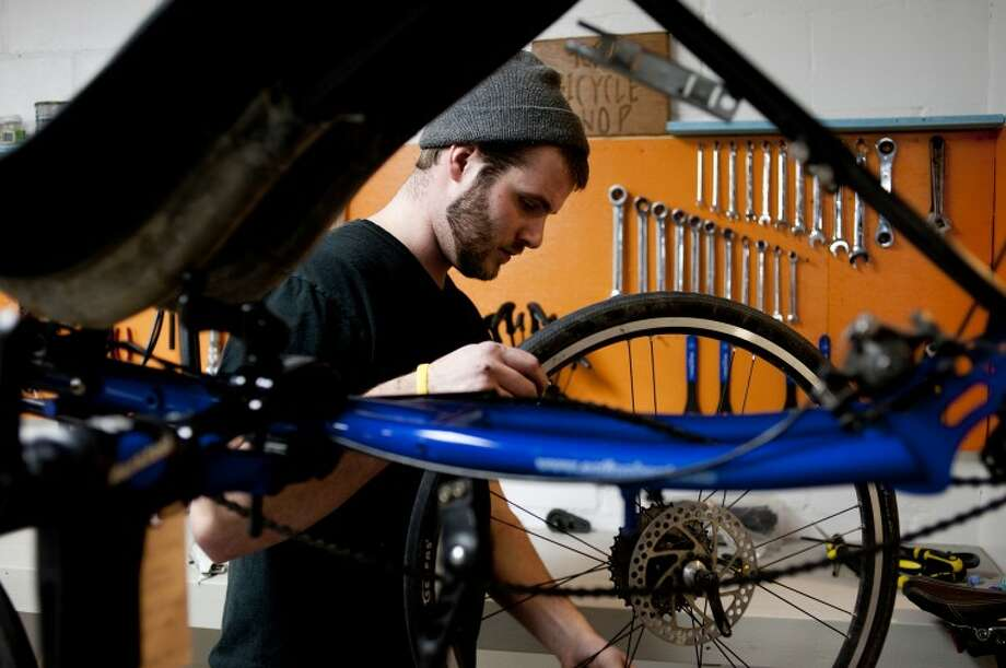 NEIL BLAKE | nblake@mdn.netTravis Willbur of Midland tunes up a recumbent bicycle at B-Xtreme Cycle & Sport on Main Street in Midland. The shop remains open while undergoing renovations that will double the size of the shop. Shop owner Todd Atkinson said  he'll be able to increase his inventory and the service area when the project is completed Photo: Neil Blake/Midland  Daily News