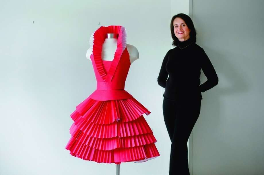 NICK KING | nking@mdn.netArtist Mica Jones and her red paper dress. Photo: Nick King/Midland  Daily News