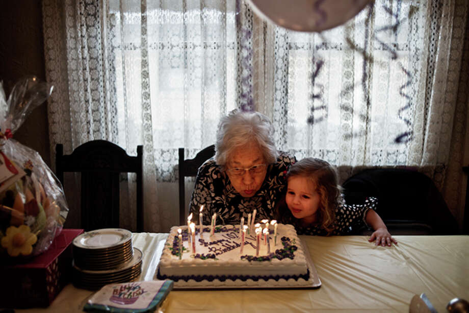 Violet Thorsberg blows out the candles on her birthday cake March 9 with the help of her great-great-niece Sophia Wiedyk, 3, while celebrating her 102nd birthday with family from around the state at her home in Midland. Photo: Sean Proctor/Midland  Daily News / Midland Daily News