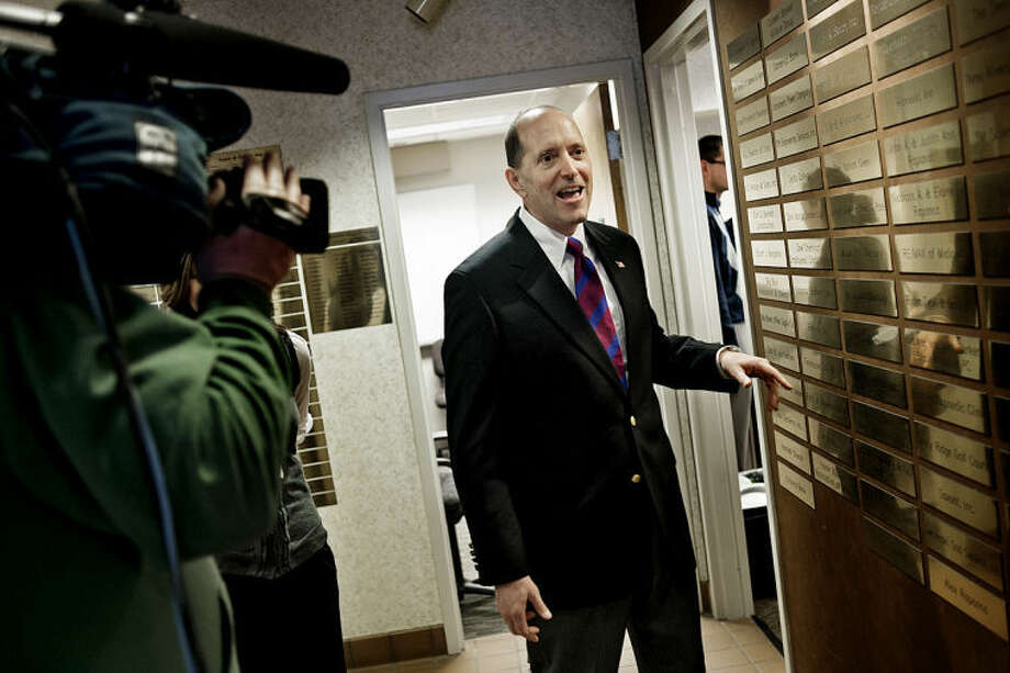 SEAN PROCTOR | sproctor@mdn.neU.S. Rep. Dave Camp, R-Midland, is greeted by local media during his visit to the Midland Area Chamber of Commerce to discuss tax issues with local small business owners. Photo: Sean Proctor/Midland  Daily News