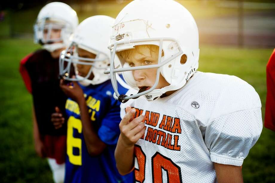 NEIL BLAKE | nblake@mdn.net Kyle Kleinhans, 10, of Midland, looks downfield during practice with his team, a Midland Area Youth Football League team called the Knights, on Monday evening at Central Middle School in Midland. League teams have started practice and game action begins next Saturday. The Knights are made up of students from Eastlawn and Carpenter Elementary Schools. Photo: NEIL BLAKE | Nblake@mdn.net