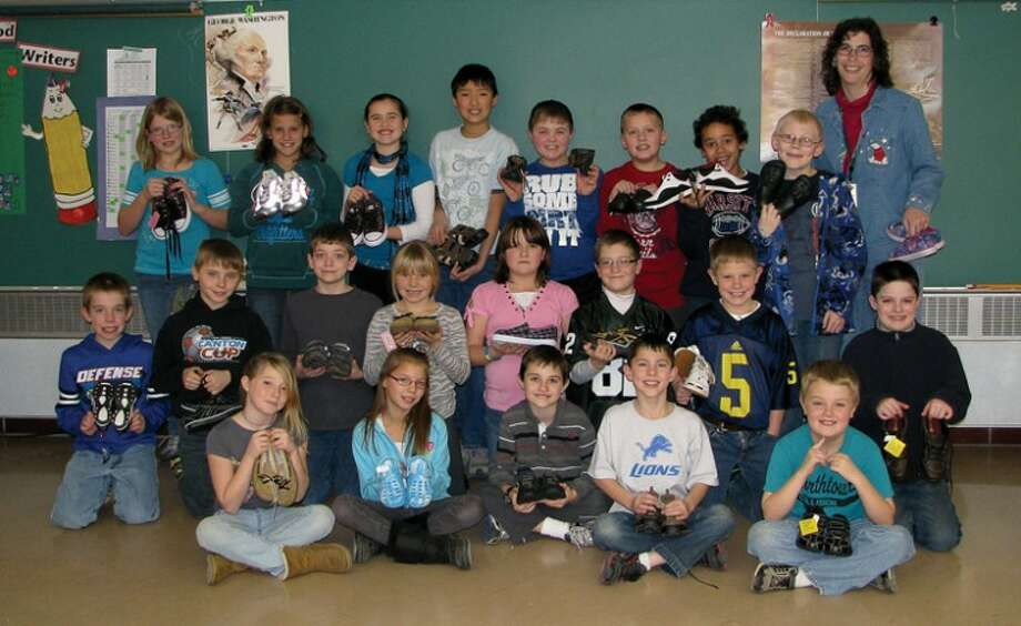 Photo providedSiebert teacher Laura Kipfmiller, standing far right, and her class of fourth-graders collected 168 pairs of shoes to aid children in Guatemala.