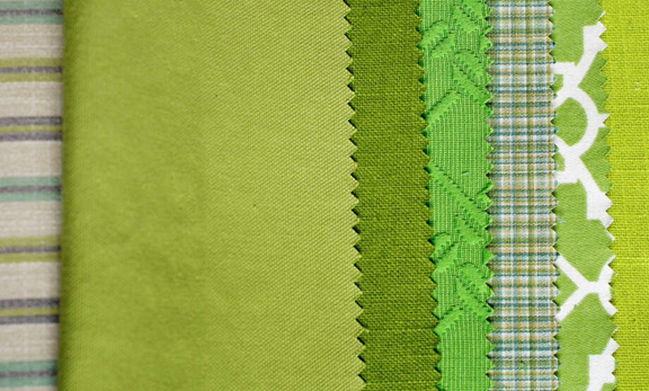 "A fabric swatch from Design Within, 219 E. Wackerly Road in Midland. Color consultant Debra Kling notes that emerald pairs well with other greens: ""In contrast to any other color family, the human eye perceives that no two greens clash. This is because we're accustomed to seeing every variant of green coexisting harmoniously in nature."" / Midland Daily News"