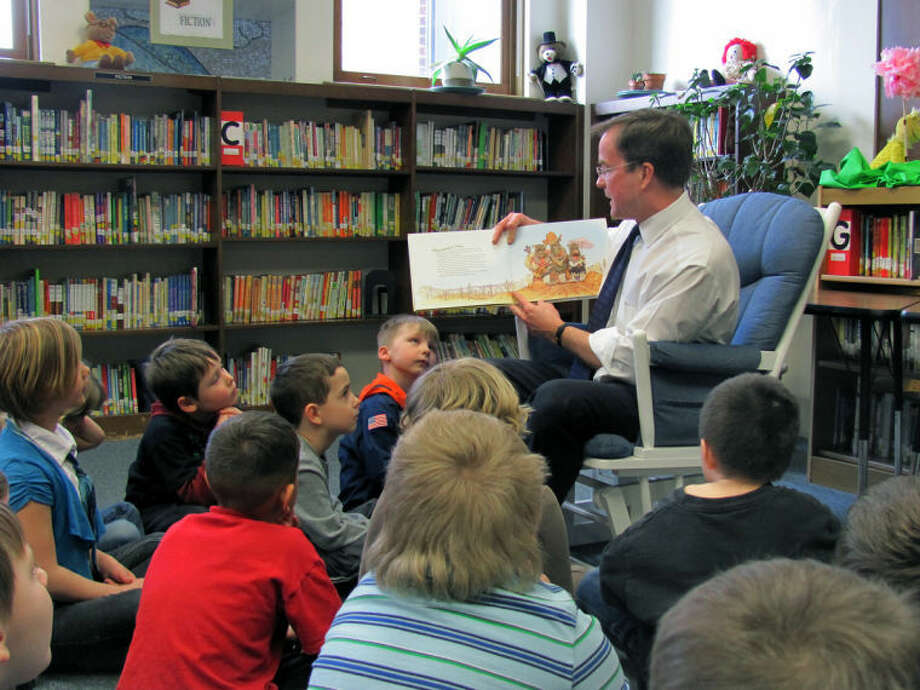 "JOHN KENNETT | jkennett@mdn.netMichigan Attorney General Bill Schuette reads to students at Carpenter Street Elementary to celebrate ""March is Reading Month."""