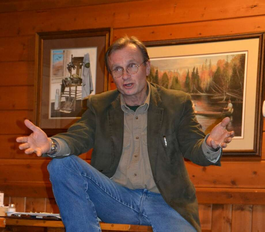 Steve Griffin | for the Daily NewsRuss Mason, chief of the Department of Natural Resources Wildlife Division, speaks Saturday to the Michigan Outdoor Writers Association at the group's winter meeting at the DNR's Ralph A. MacMullan Conservation Center at Higgins Lake.