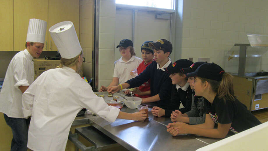 Middle school students learn lessons in culinary arts. Photo: Photo Provided