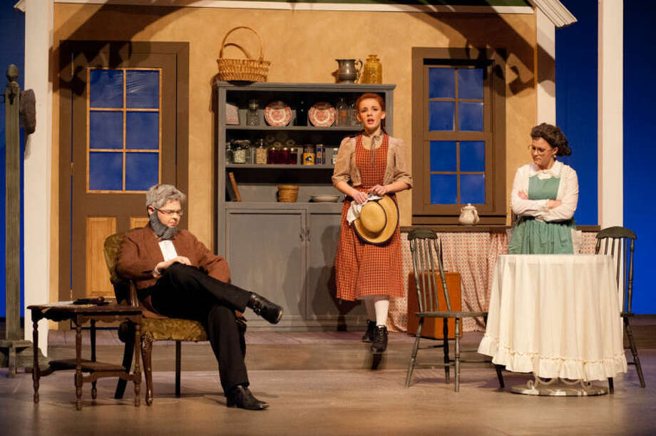 """STEVEN SIMPKINS/Daily News Josh Danielson as Matther Cuthbert, Liz Doerr as Anne Shirley and Maddy Futter as Marilla Cuthbert in the Midland Center for the Arts Peanut Gallery production of """"Anne of Green Gables."""""""