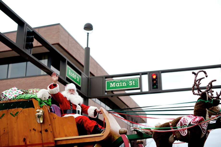 Santa Claus closes out the Midland Santa Holiday parade on Saturday on Main Street in downtown Midland. Photo: THOMAS SIMONETTI | Tsimonetti@mdn.net