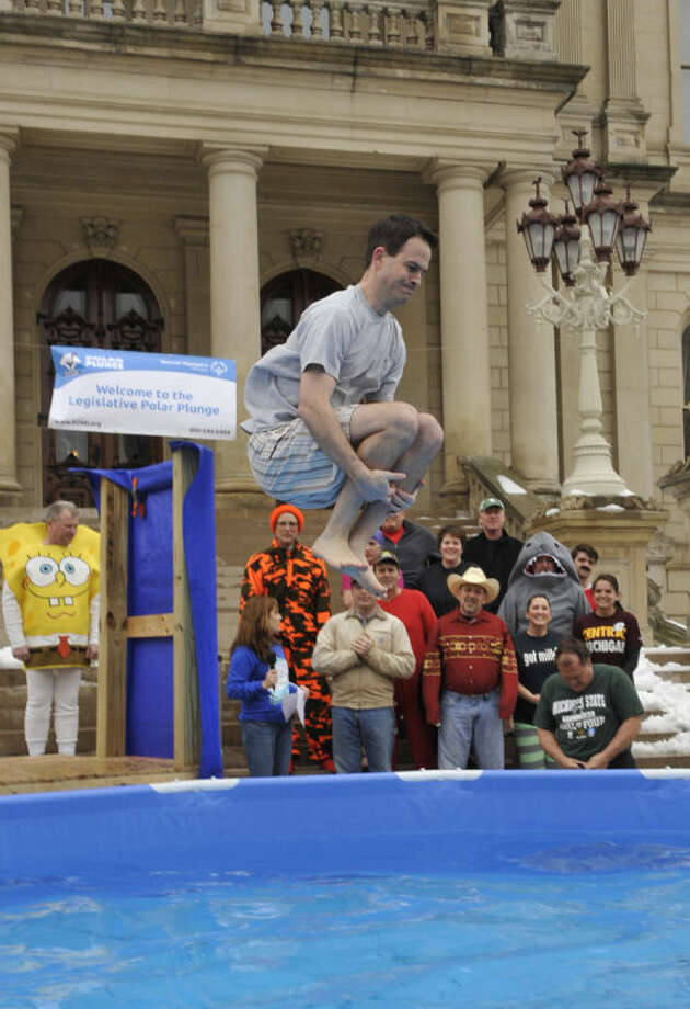 Photo providedState Rep. Kevin Cotter, R-Mount Pleasant, does a cannonball as he enters the icy pool in support of Special Olympics. Cotter was a co-chair of the fundraiser which raised more than $30,000.