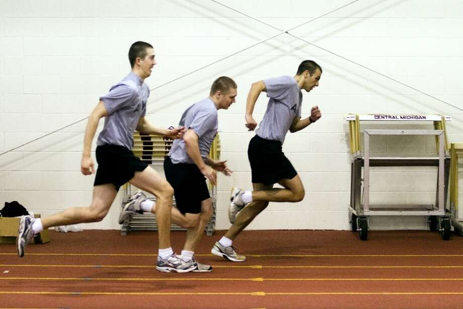 "JAKE MAY | for the Daily NewsCentral Michigan University sophomore Benjamin A. Kozuch sprints at the front of a group of ROTC cadets during a workout at the Indoor Athletic Center in Mount Pleasant. Kozuch, a graduate from Midland High School, was nominated for West Point by U.S. Rep. Dave Camp. ""I want to serve my country,"" Kozuch said. ""I consider it a great honor to be nominated."""