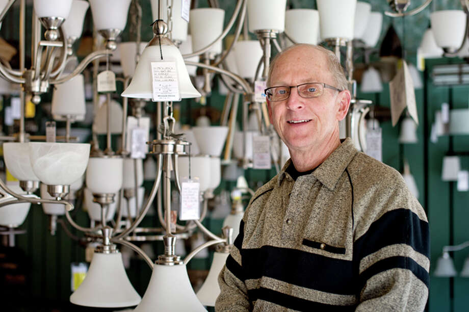 NICK KING | nking@mdn.net Richard Dodick, owner of Wholesale Electric, offers a wide variety of lighting for all your household needs. Photo: Nick King/Midland  Daily News / Midland Daily News