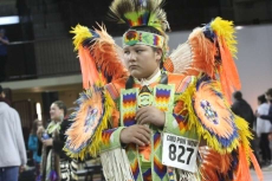 Photo providedGegek Pamp, 14, wears vibrant regalia as a fancy feather dancer at the CMU Pow wow.