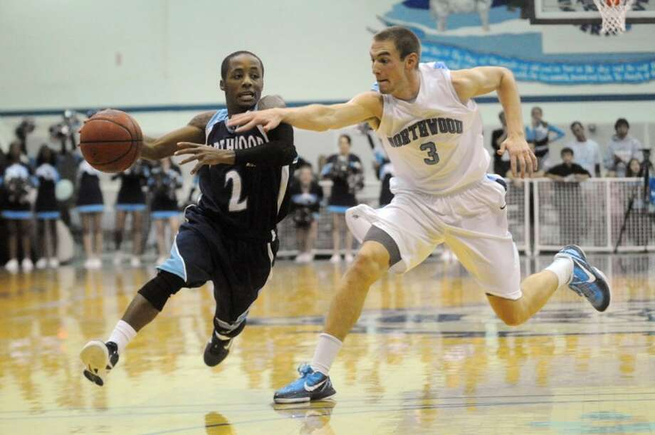 Northwood Seahawks' Tyrane Davis, left, races down the court guarded by Northwood Timberwolves' Andrew VanDierenDanck on Monday at the Bennett Sports Center during the President's Cup matchup. Photo: NEIL BLAKE | Nblake@mdn.net