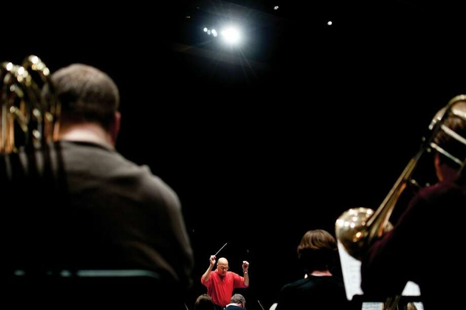 LIBBY MARCH | for the Daily NewsMembers of the Midland Symphony Orchestra rehearse at the Midland Center for the Arts auditorium. Photo: Libby March