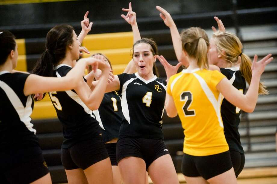THOMAS SIMONETTI | tsimonetti@mdn.netBullock Creek's Alyssa Schumaker (4) celebrates a point with teammates in Monday's district volleyball match against Hemlock at Bullock Creek.