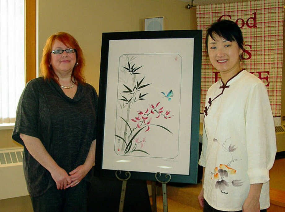 Photo providedMary Gilbert, left, purchased the Chinese Brush Painting created by Louise Chen.
