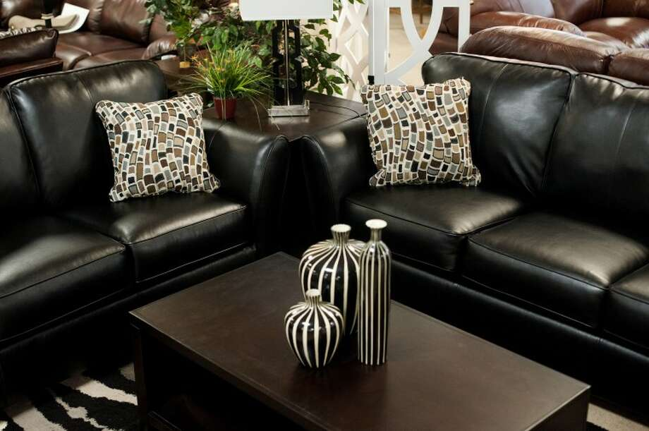 NEIL BLAKE | nblake@mdn.netA blended leather living room set from Ashley sits in a display room to give customers an idea of what the furniture could look like in their home. Photo: Neil Blake/Midland  Daily News