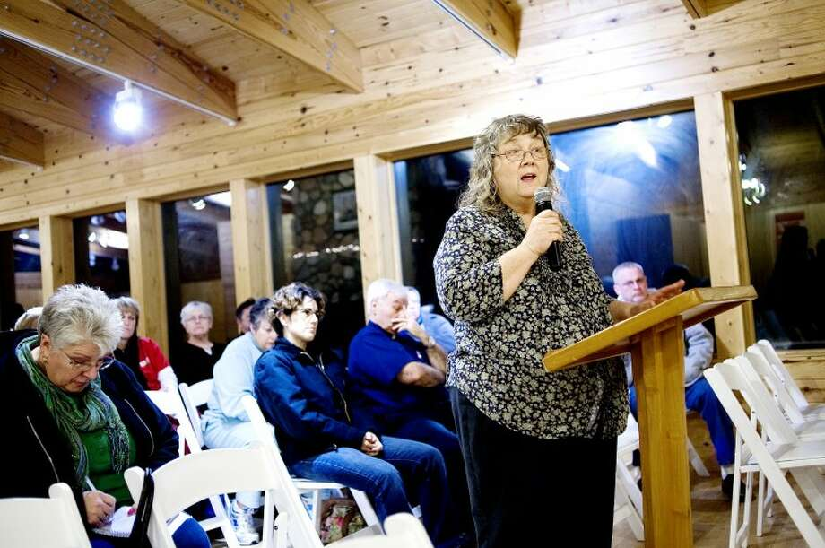 NICK KING | nking@mdn.net Linda Barth, a long-time Midland relator, speaks about her concerns with the housing market in the current economic climate during a town hall meeting Monday at Whiting Forest. The meeting, which about 30 people attended, was held in order for citizens to voice their concerns and questions about how the super committee and Congressman Dave Camp will act on the current economical problems. Comments from citizens were recored and will be sent to Congressman Camp. The meeting was put on by Progress Michigan and the Michigan Nurses Association. A nameplate for Congressman Camp sat on a table in front of an empty seat to represent Camp's absence from the meeting. Photo: NICK KING | Nking@mdn.net