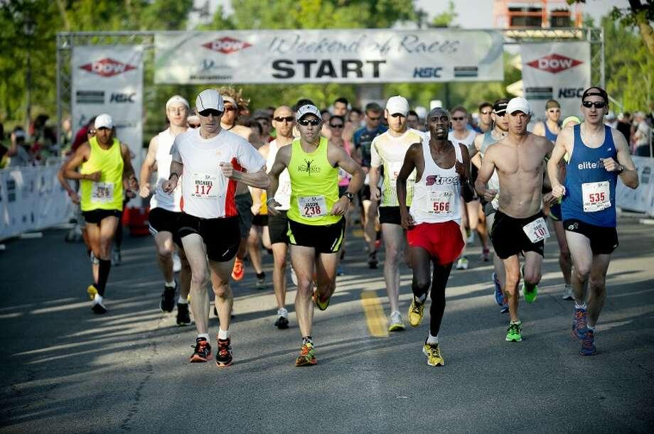 NEIL BLAKE | nblake@mdn.netThe lead runners in The Qualifier marathon start their way toward Bay City on Sunday.