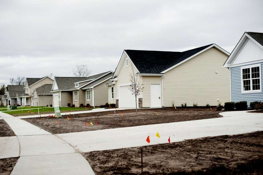 A row of homes off Butterfield Drive are being equipped with sensors to collect data about moisture, temperature changes to name a few in order to find out how well certain home energy savings methods work. Photo: NICK KING | Nking@mdn.net