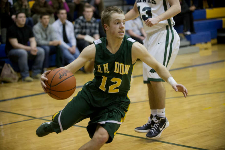 NEIL BLAKE   nblake@mdn.netDow's Gavin Groszek drives to the hoop in the district semifinal game against Saginaw Heritage at Midland High School on Wednesday. Photo: Neil Blake/Midland  Daily News