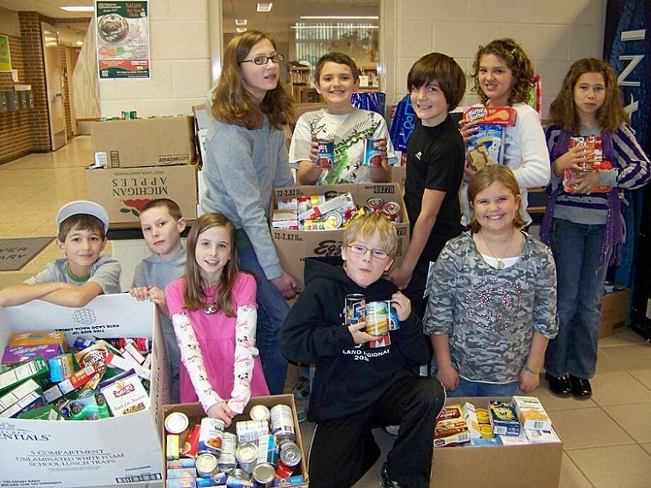 Photo providedStudents at Bullock Creek's Pine River Elementary are shown with the items they collected during a recent food drive.