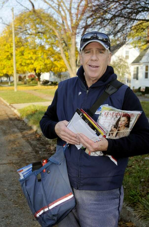 "AP Photo | The Saginaw News, Jeff Schrier)U.S. Postal Service carrier James A. ""Jim"" Davis poses for a picture in Saginaw. Davis called police after mail piled up for three days at the home of Fred Kline, 82, of Saginaw. Kline had fallen in his home, breaking his hip and ended up lying on his floor for three days before Davis intervened. Kline has since had a partial hip replacement and is now living in an assisted living facility. Photo: Jeff Schrier"